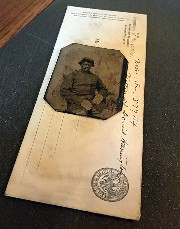 HIDDEN FOR ALMOST A CENTURY: The tintype of Warrington and the envelope in which it was stored. Sixth-plate tintype by an anonymous photographer. National Archives.