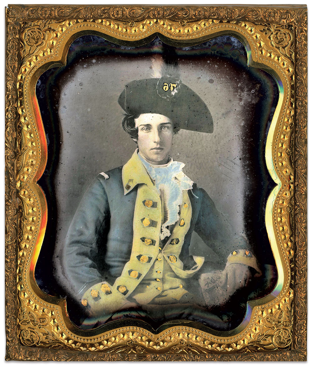 """This militia private in Continental-style uniform proudly wears his cocked hat with red and black plume and black silk cockade with numerals """"76"""" at its front. His blue coat with buff facings echoes that adopted by the General Staff of the Continental Army in 1775. The loops on his shoulders served to help hold epaulettes in place when worn. Sixth-plate daguerreotype by an anonymous photographer. Mike Medhurst Collection."""