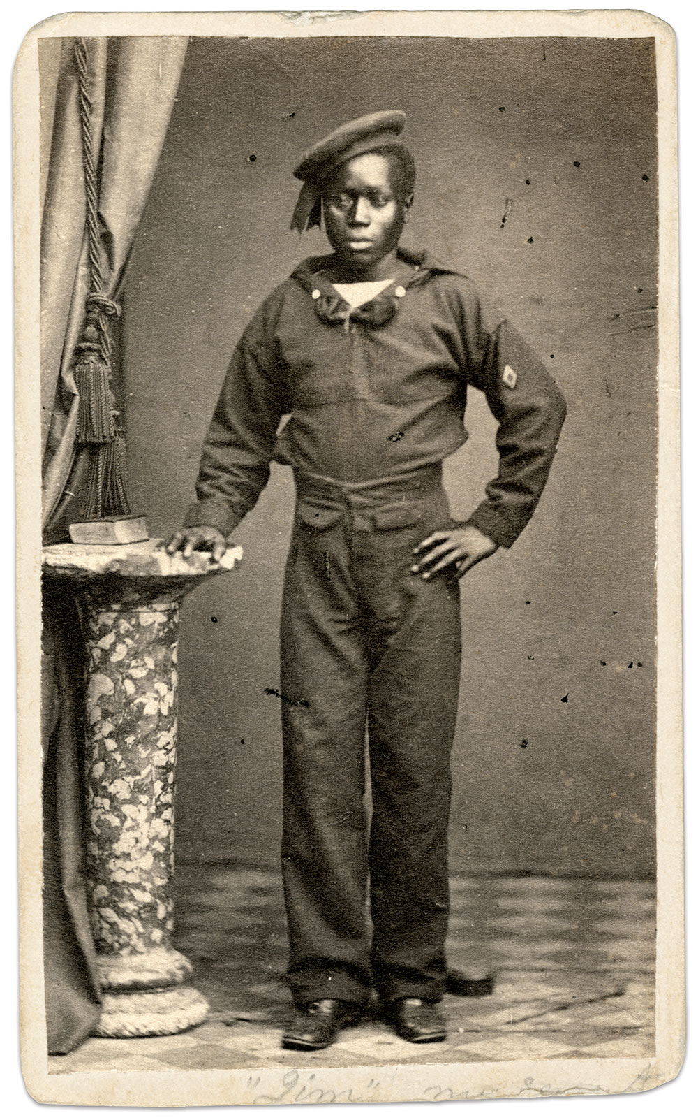 """Identified on the reverse of this image only as """"'Jim.' Steward. Star[boar]d Steerage Mess,"""" this sailor wears a diamond-shaped watch mark on the left sleeve of his jumper, which indicated the starboard watch on his particular vessel. Carte de visite by an anonymous photographer. National Museum of African American History & Culture."""