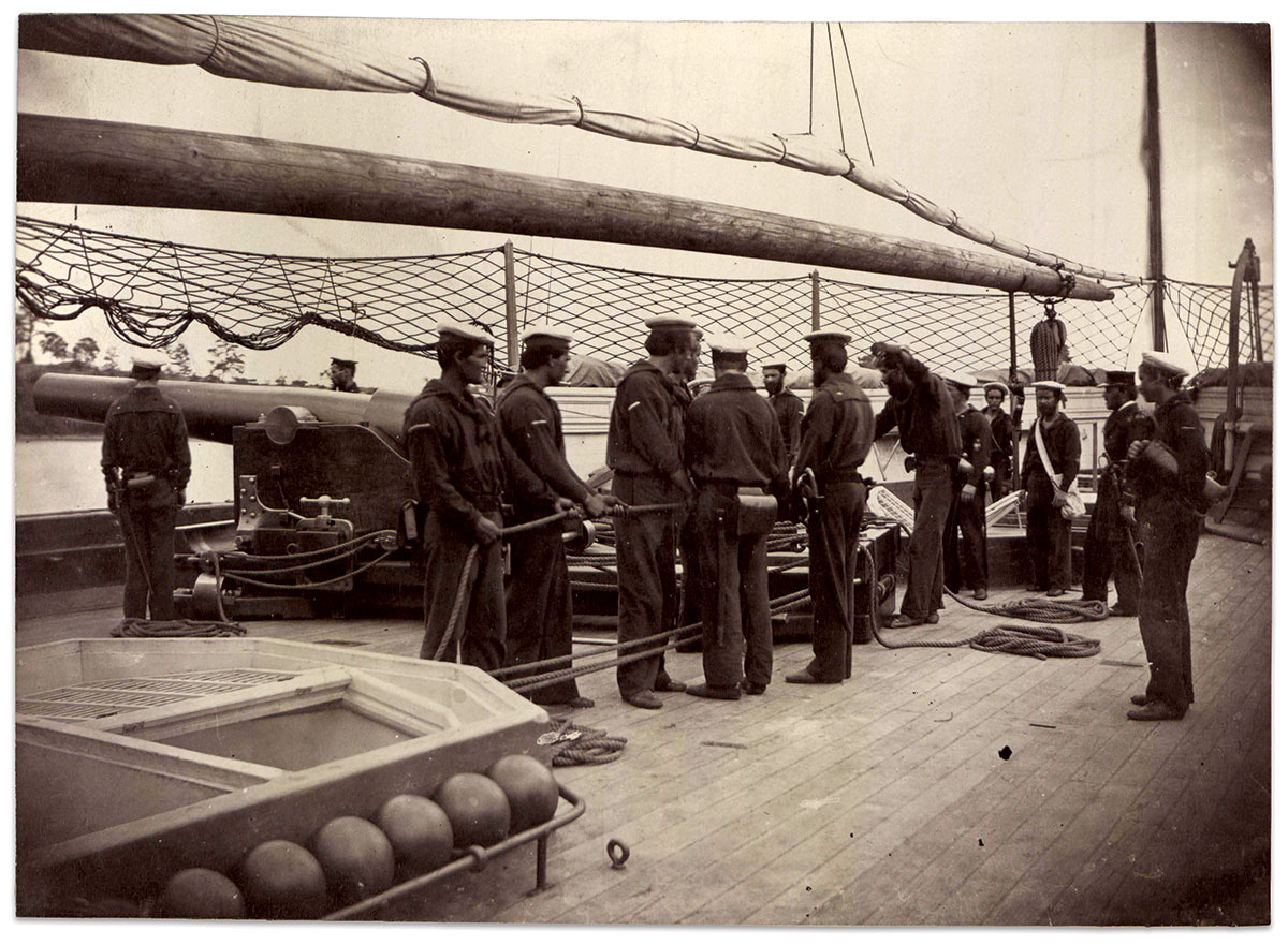Members of the crew manning a 10-inch Parrott gun aboard the Sassacus class gunboat Mendota have horizontal watch marks on the sleeves of their jumpers. Albumen by an anonymous photographer. United States Army Heritage & Education Center, Military Order of the Loyal Legion of the United States, Photograph Album Vol. 15, p. 702.