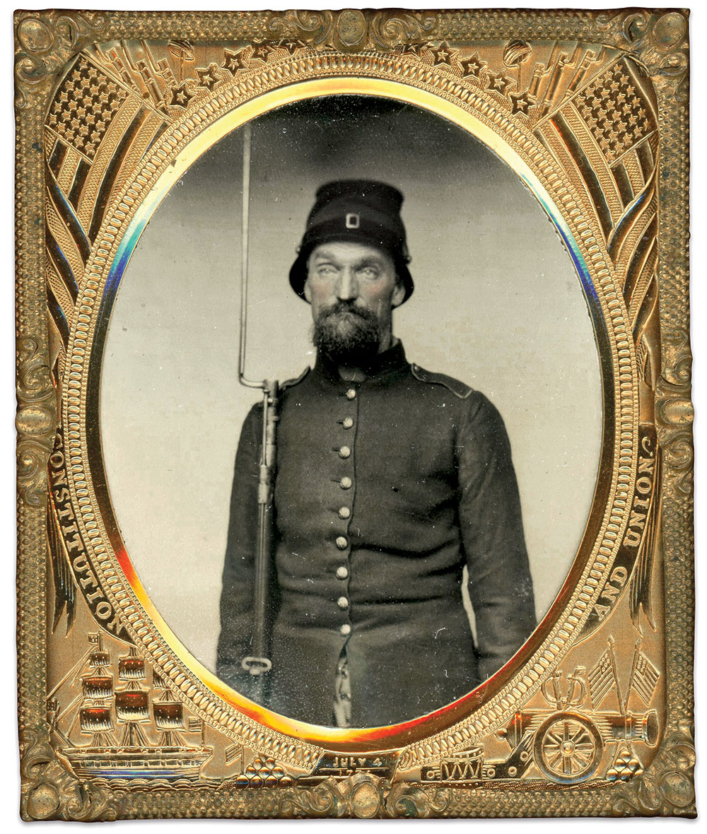 Joseph Foster, a private in Company H of the 8th New Hampshire Infantry, wears the modified version of the Havelock cap also issued to his regiment. Made by Haley's Tailoring Establishment at New Market, N.H., his frock coat was of the same pattern and inferior quality as that produced for the 6th New Hampshire Infantry by Lincoln & Shaw. Sixth-plate ambrotype by an unknown photographer. Dan Binder Collection.