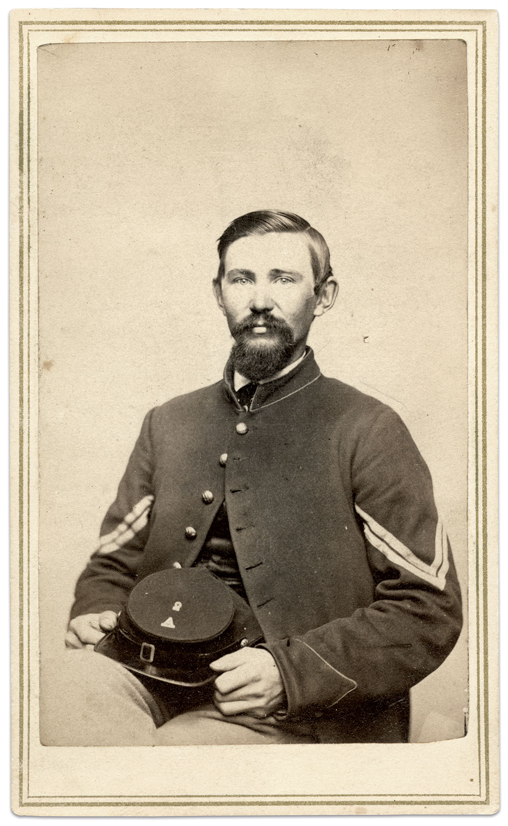 Photographed circa 1864-65, this unidentified corporal of Company A, 2nd New Hampshire Infantry, has simply has the metal letters 2 and A on his cap top. Carte de visite by French & Sawyer, Keene, N.H. Ron Field Collection.