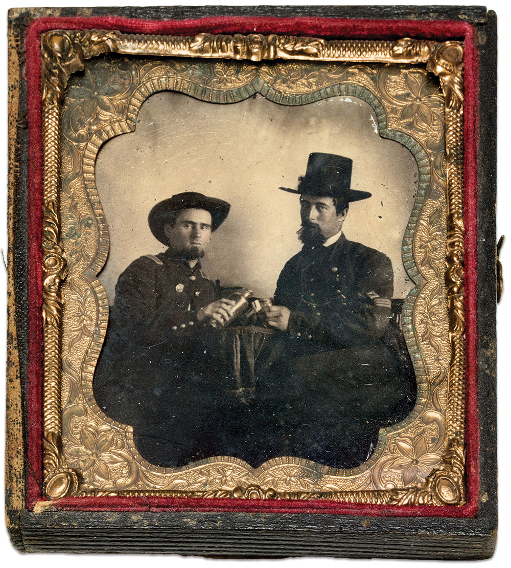Lt. Ogle, left, fills the glass of a 1st sergeant. Sixth-plate ambrotype by an anonymous photographer. Author's Collection.