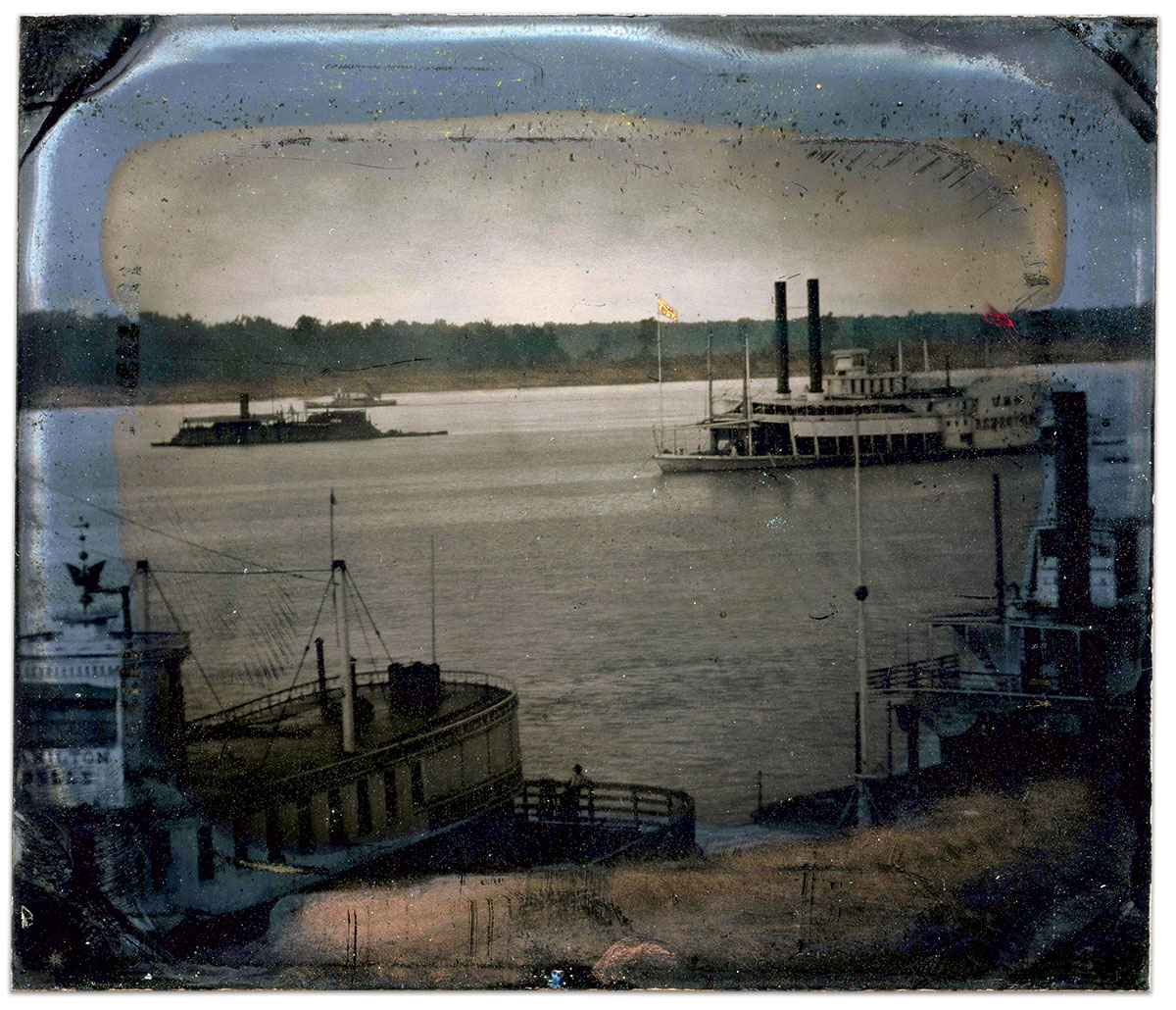"""The Hamilton Belle is moored nearest the camera. In the middle distance is a vessel with the designation """"U.S.N. DESPATCH"""" on the paddle box, one of at least three such ships operating on western rivers. The familiar box shape of an Eads gunboat is visible further midstream. Sixth-plate tintype (reversed) possibly by Andrew D. Lytle of Baton Rouge, La."""