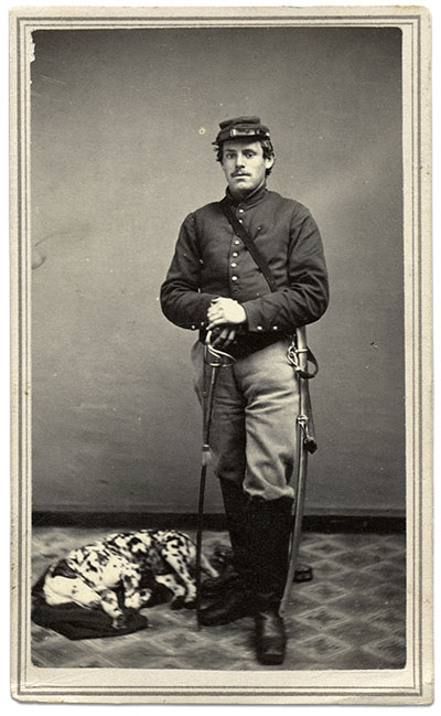 The individualism of the American soldier is evident in this federal cavalryman in full gear. He stands at the ready with his saber, while his trusty Dalmatian lay asleep on a blanket on the floor by his side. Carte de visite by L.P. Case of Champlain, N.Y. Author's collection.