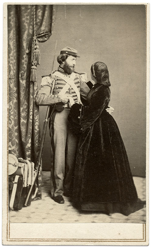 The drama conveyed in this scene feels Shakespearian. The soldier, a member of the 7th New York State Militia, tenderly holds one hand of his love while she rests her free hand on his epaulette. Carte de visite by an anonymous photographer. Rick Carlile Collection.