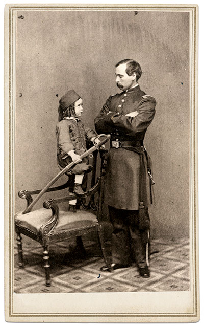 The Zouave mystique extended beyond military uniforms, as evidenced by the costume worn by this child. He holds the Model 1860 cavalry saber that likely belongs to the first lieutenant who stands by his side. The officer may be his father.Carte de visite by Caleb L. Howe of Brattleboro, Vt. The Liljenquist Family Collection at the Library of Congress.