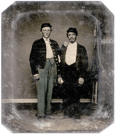 """""""Grandpa"""" Langhans, as John Langhans of the 154th New York Infantry would later become known to his family, with his friend """"Bandaged Thumb,"""" in May or June 1865. Sixth-plate tintype by Bell & Brother of Washington, D.C. Author's collection."""