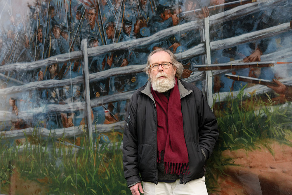 Dunkelman stands in front of his mural, a must-see stop for visitors to Gettysburg. Melissa A. Winn.