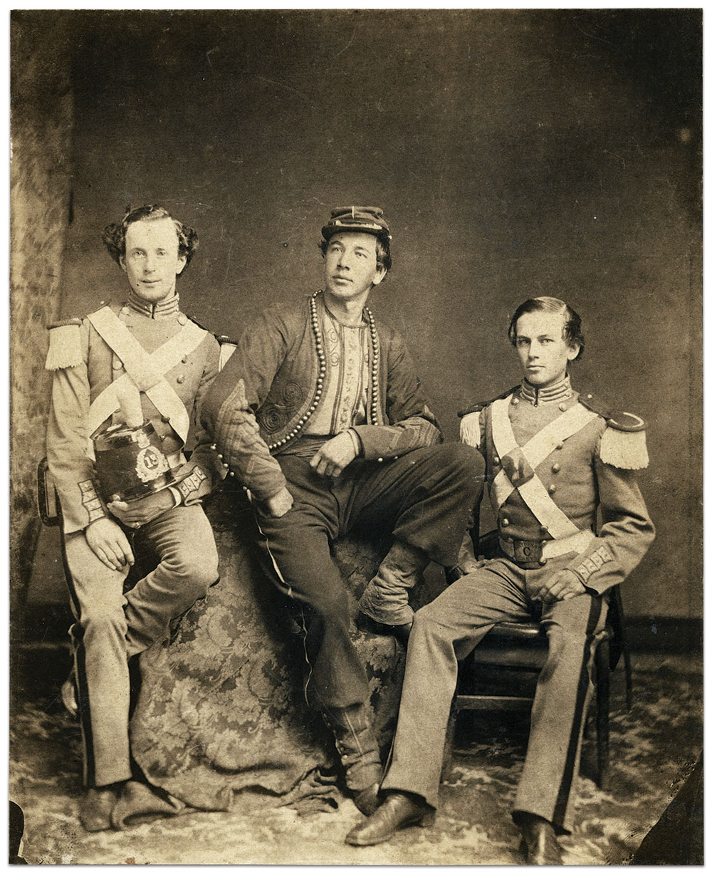 Two members of the 13th in their regimental dress uniform with shako pose with a United States Zouave Cadet. While the 7th Regiment hosted the Zouave Cadets in Manhattan, the 13th acted as hosts in Brooklyn.Albumen print by an anonymous photographer.