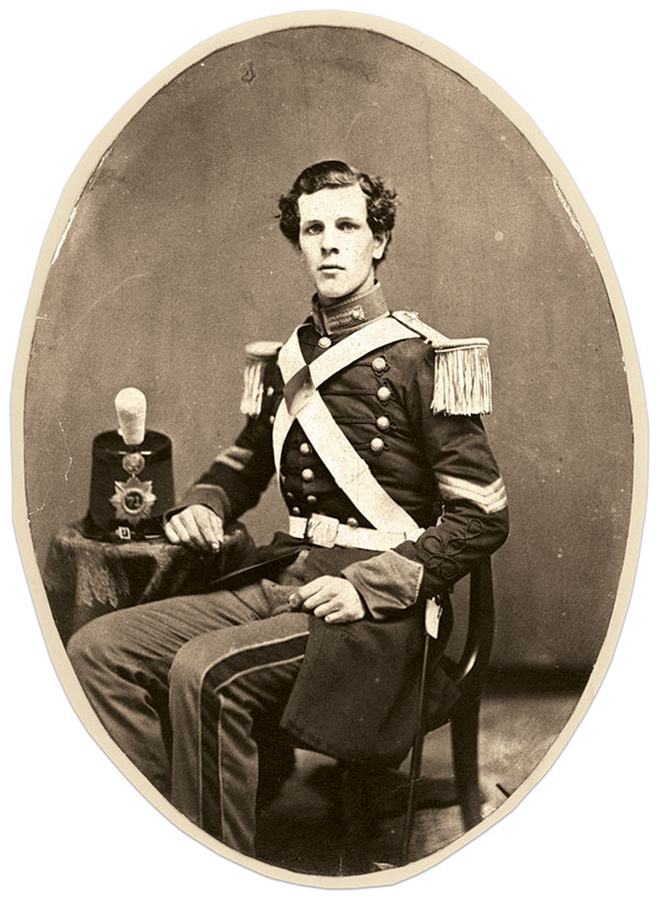 CLASSIC NEW YORK MILITIAMAN: The dress uniform worn by Sgt. Edwin W. Finley of the 71st State Militia in this portrait represents the city's militia style circa 1860. He wears a dark blue frock coat with sky blue collar and cuffs trimmed with black cord and gold lace, and white epaulets with light blue worsted crescents. His cap features a sunburst plate with the number 71 at its center. Finley went on to participate in the Gettysburg emergency and Draft Riots as first lieutenant of Company E. After the war he settled in Avon, N.J., where he died in 1900 at age 63. Albumen print by an anonymous photographer. Collection of the late Michael J. McAfee.
