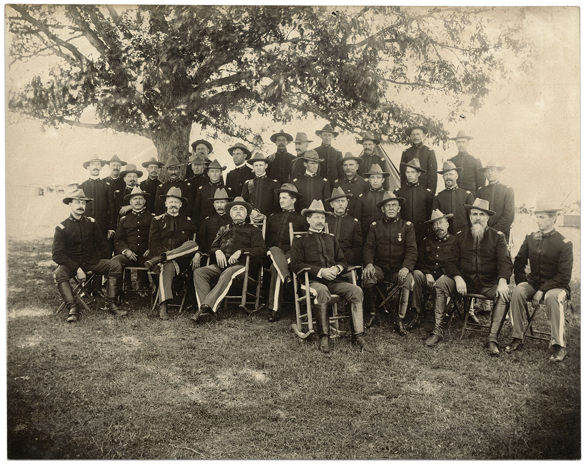 Capt. Fisher and his fellow officers of the 1st Maryland Volunteers about the time of their service in the War with Spain. Fisher stands third from left. At least two other officers in the regiment were Civil War Veterans: 3rd Battalion commander Maj. Joseph Phipps (not pictured) served in the 17th Indiana Infantry and 7th Indiana Cavalry, and Chaplain Coupland Randolph Page (1843-1922), seated fourth from left, served in the Liberty Hall Volunteers, which became Company I of the 4th Virginia Infantry, part of the famed Stonewall Brigade. Considering the ages of those pictured here, others may have served in the Union and Confederate armies. Print by Ivan White of Belair, Md. Kirk Fisher Collection.