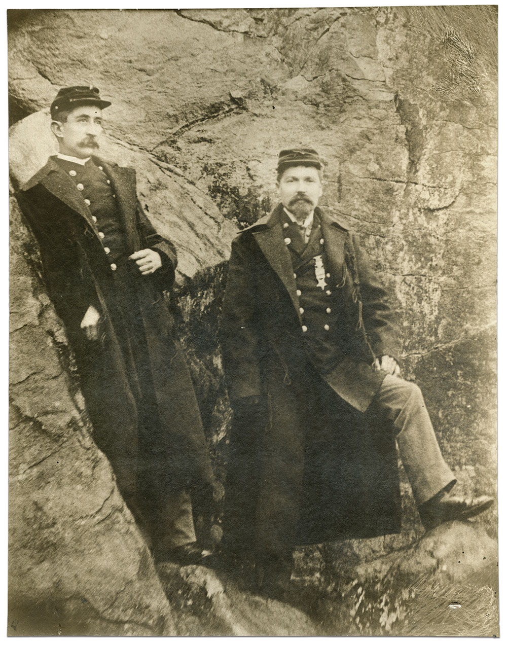 The Maryland National Guard frequently made pilgrimages to the battlefield at Gettysburg. Here, Fisher, right, dressed as an officer in the Hagerstown Light Infantry, poses with another officer on the rocks of Devil's Den, circa 1890. Fisher wears his G.A.R. membership medal. Print by an anonymous photographer. Kirk Fisher Collection.