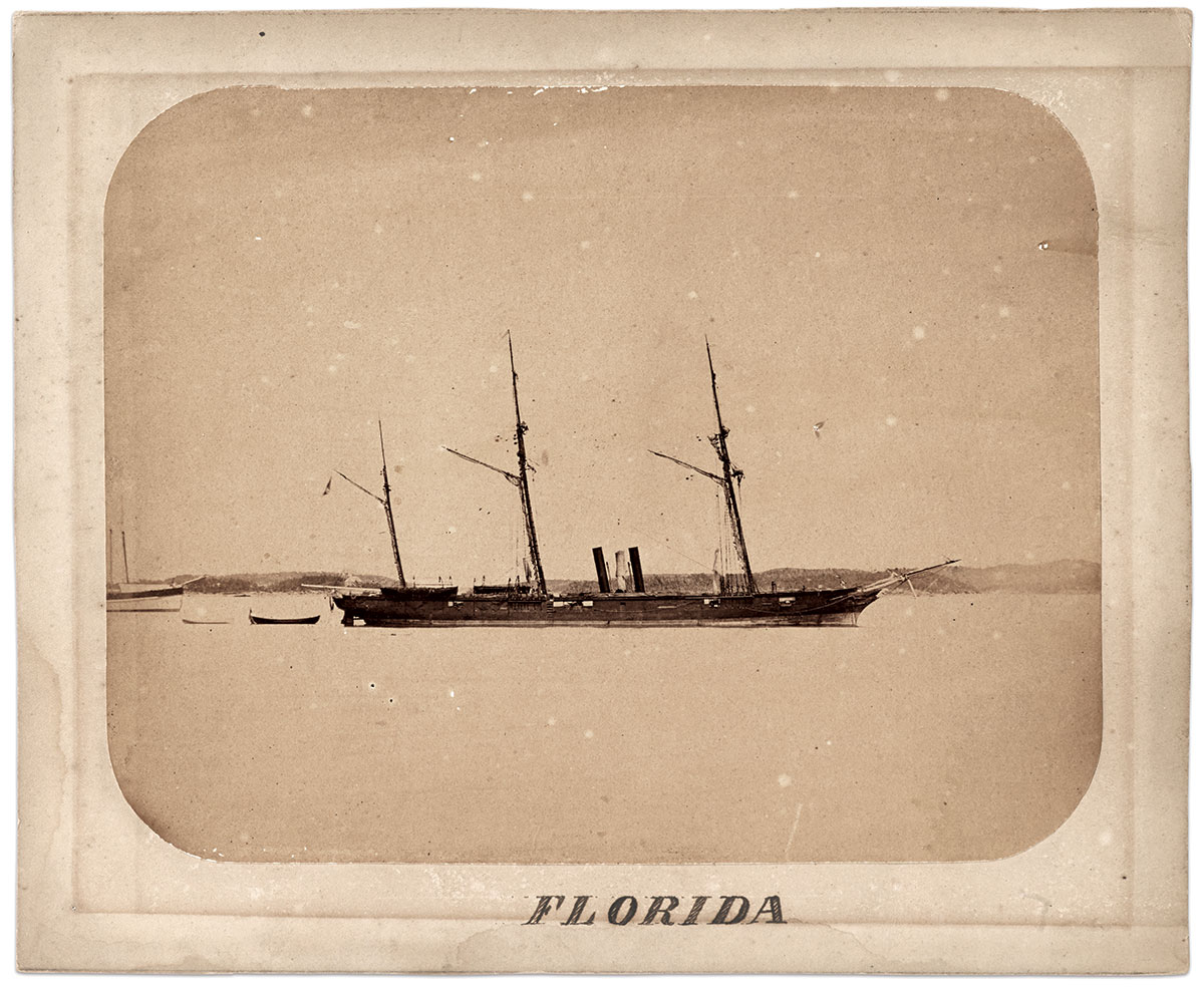 """Stainless Banner in Bermuda: The cruiser Florida with second national flag, or """"Stainless Banner,"""" flying from the stern mast. This image is frequently mistaken as having been photographed in Brest, France, but was actually produced in St. George's Harbor, Bermuda, circa 1863-1864. Mounted albumen by S.W. Gault. Courtesy of the Bermuda Historical Society, Bermuda Archives, Hamilton, Bermuda."""