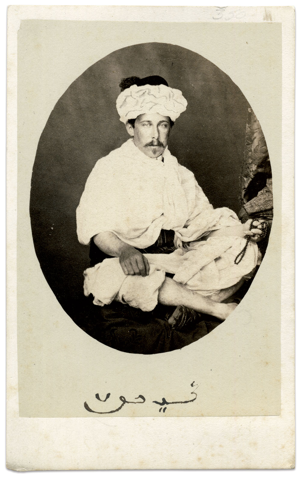 Turban, Robe, and Prayer Beads: Gihon in the costume of the Jebala people of northwestern Morocco. Carte de visite by an anonymous photographer. Author's Collection.