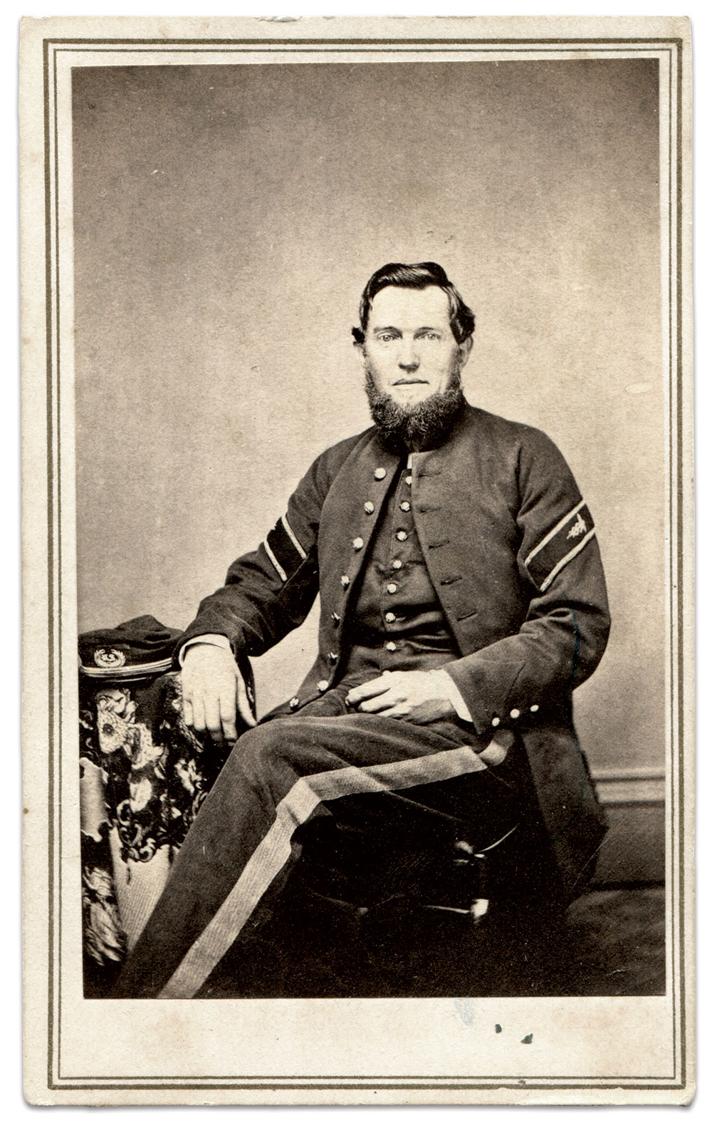 """This hospital steward displays the distinctive chevron on his sleeves and the wide stripe of a non-commissioned officer on his trousers. The cap has the proper insignia of a laurel wreath with """"US"""" in the center, not """"MS."""" Carte de visite by E.H. Clark of Great Barrington, Mass. Steven Karnes Collection."""