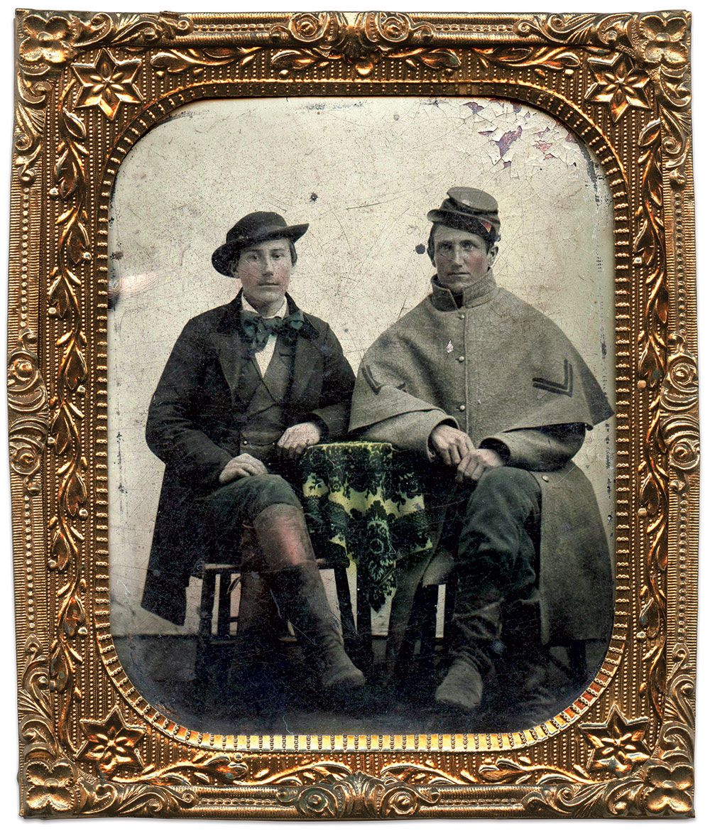"""Tyner and his soldier-brother: Oscar Newton """"Ock"""" Tyner sits next to his brother, William, a corporal in Company B of the 38th Illinois Infantry. The author suggests this portrait was made upon William's enlistment in 1861 due to the crisp overcoat (note the unusual and nonregulation placement of the chevrons). This image may have been taken by David P. Barr in his Illinois studio—prior to his travels to Memphis and Vicksburg. Sixth-plate tintype attributed to David P. Barr of Effingham County, Ill."""