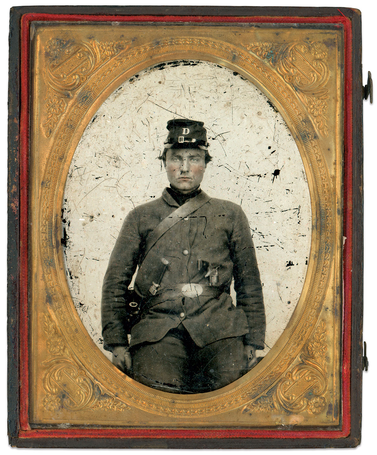 An unidentified infantryman of Company D wears his stock with a standard issue fatigue uniform and cap. Quarter-plate tintype by an anonymous photographer. Rich Jahn Collection.