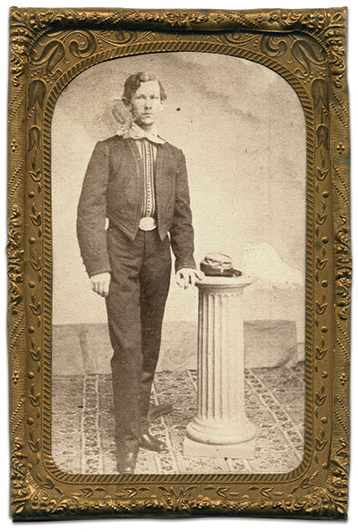 Pictured in his Maryland Guard half fatigue uniform about 1861, Howard wears dark trousers of the fatigue or undress uniform with the full-dress Zouave-style jacket. Note the Company C designation on the front of the cap resting on the pedestal. Carte de visite by an anonymous photographer housed in an eighth-plate mat.