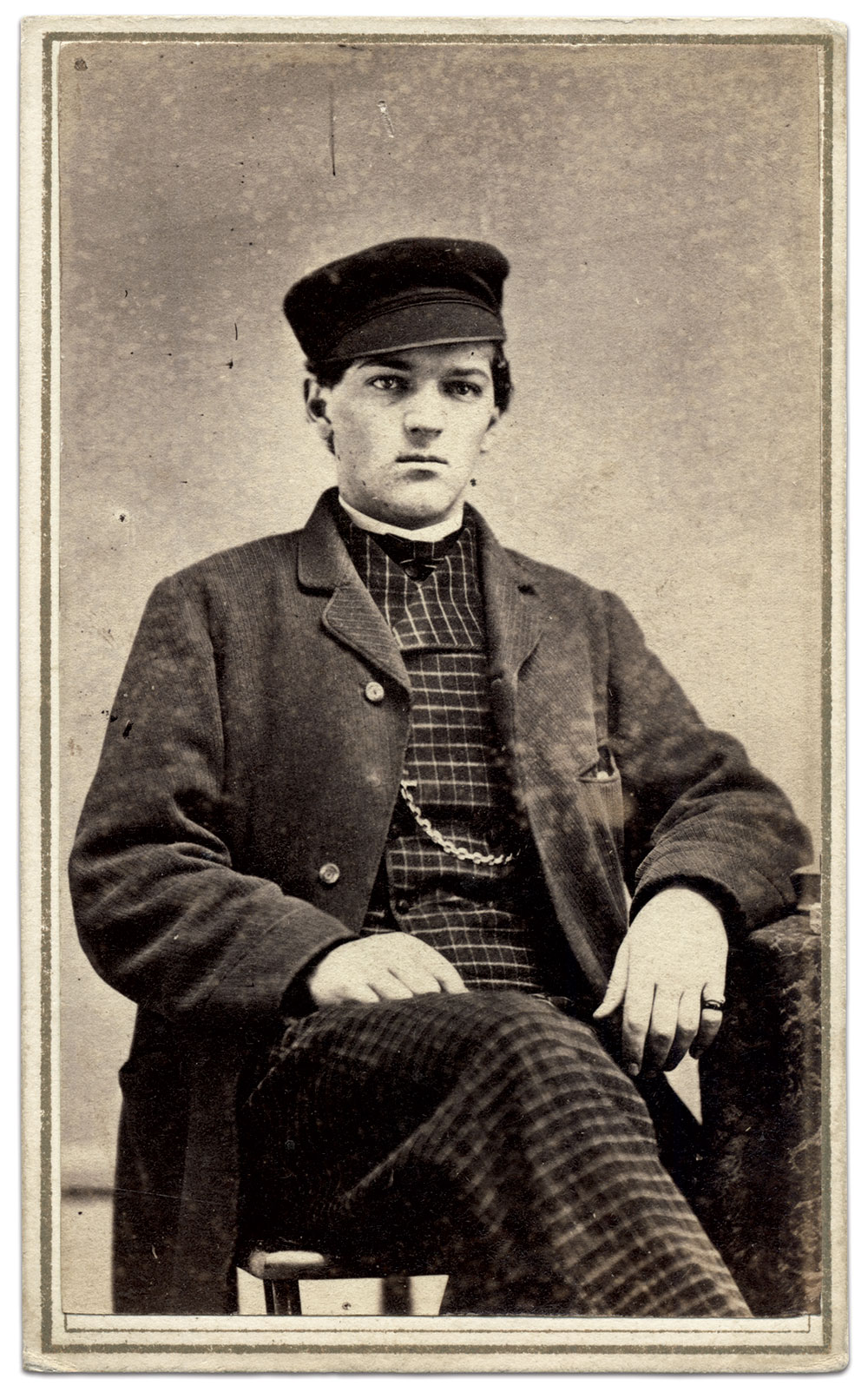 Homer W. Gilbert appears in a civilian sack coat and checkered vest and trousers with cloth cap. On April 10, 1865, he was captured by rebel guerillas near Memphis with five or six other men. He was released unharmed the next day. Carte de visite by H. G. Taylor of Adams, N.Y. Michael J. McAfee Collection.