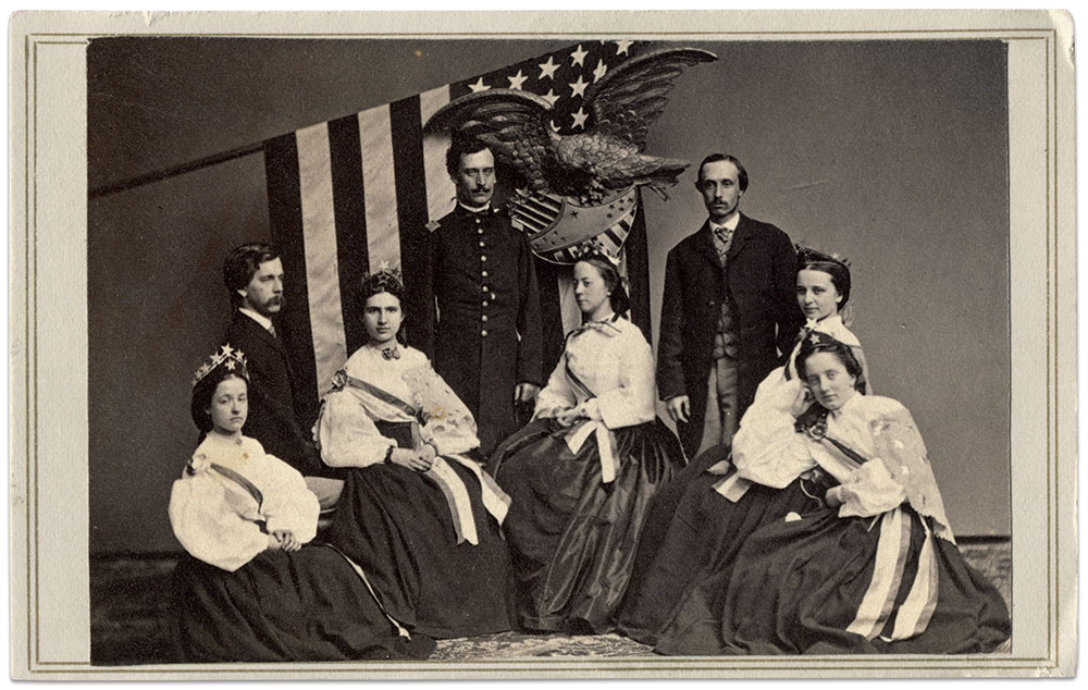 This group of unidentified ladies in patriotic garb were likely stationed in a fair booth or exhibit. The wearing of crowns emblazoned with stars and other symbols of the republic were common at these events. Carte de visite by an anonymous photographer. Michael J. McAfee Collection.