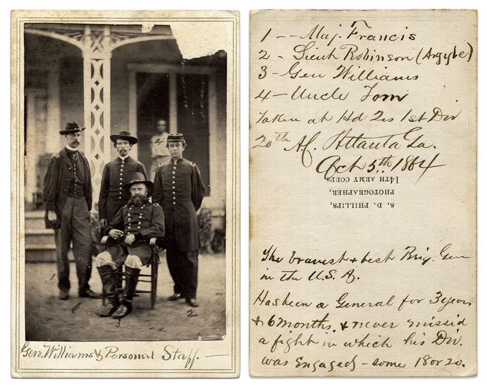 """""""The Bravest & Best Brig. Gen. in the U.S.A."""" These words are written on the back of this portrait of Williams and his personal staff. Standing on the left is Maj. James Francis (1840-1898) of the 2nd Massachusetts Infantry. On the right is 1st Lt. George Robinson (1841-1920) of Argyle, N.Y., who served in the 123rd New York Infantry. """"Uncle Tom"""" is the man on the porch. The unidentified officer in the center is likely the individual who penned the inscription. Carte de visite by S.D. Phillips, 14th Army Corps. Steve Meadow Collection."""