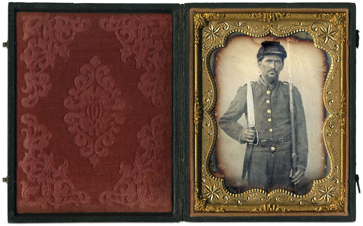 This Southron brandishes a D-Guard Bowie knife and a Model 1816/1822 musket. Pay special attention to his cap—the dark material thrown over the top may be a Havelock, used primarily during the earliest part of the war. It might also be a loose-fitting rain cover. Quarter-plate daguerreotype by an anonymous photographer.
