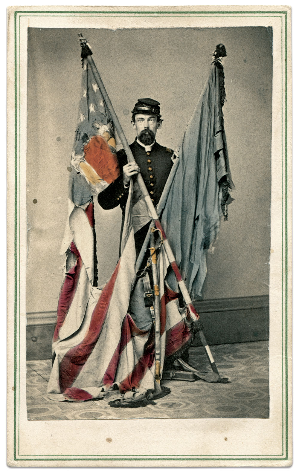 An unidentified officer with national and state colors. Carte de visite by Kennedy & Schenck of Newark, N.J. Rick Brown Collection.
