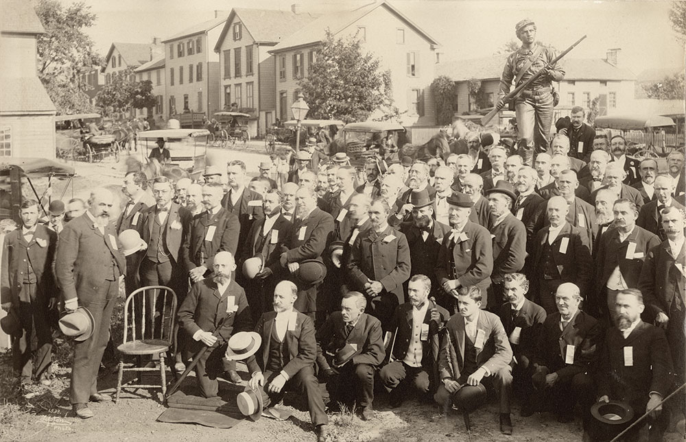 Veterans of the 26th participate in the Gettysburg monument dedication ceremony on Sept. 1, 1892. Col. Jennings stands in front of the chair, and behind it is Pvt. Pennypacker. Capt. Klinefelter stands fourth to the right of Jennings. Albumen print by an anonymous photographer. Special Collections, Musselman Library, Gettysburg College.