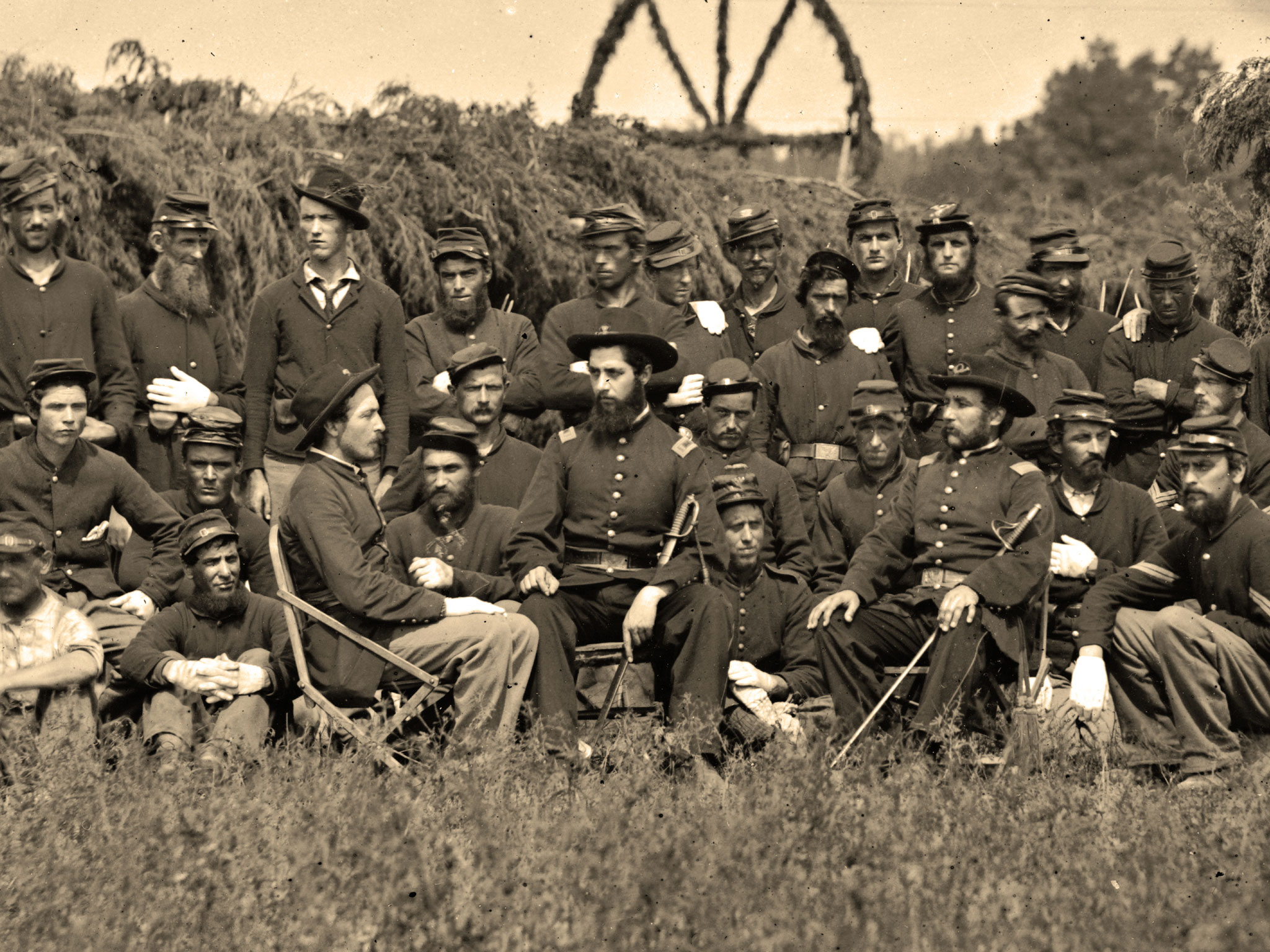 Ball is pictured again in O'Sullivan's group portrait of the enlisted men and officers in Company K of the 93rd. He sits here on the rightin a camp chair with his sword. In the center sits 1st Lt.Robert Stoddart Robertson (1839-1906), who received the Medal of Honor for his courage on May 8, 1864, at Corbin's Bridge, Va. Library of Congress.