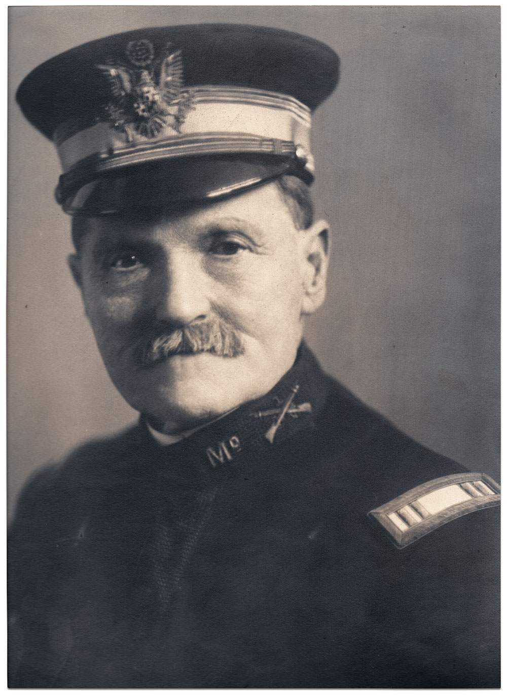 Capt. Fisher sat for a portrait in a local Hagerstown photographer's studio around the time of his retirement in 1911. He wears the regulation Maryland National Guard uniform, including the Model 1902 officer's cap modified for state use with the Maryland flag pattern in the shield of the insignia. Print by a Hagerstown photographer. Collection of the Pioneer Hook and Ladder Company, Hagerstown, Md.