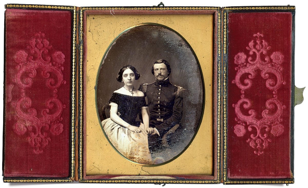 Half-plate daguerreotype by an anonymous photographer, housed in a double-door paper and wood case.