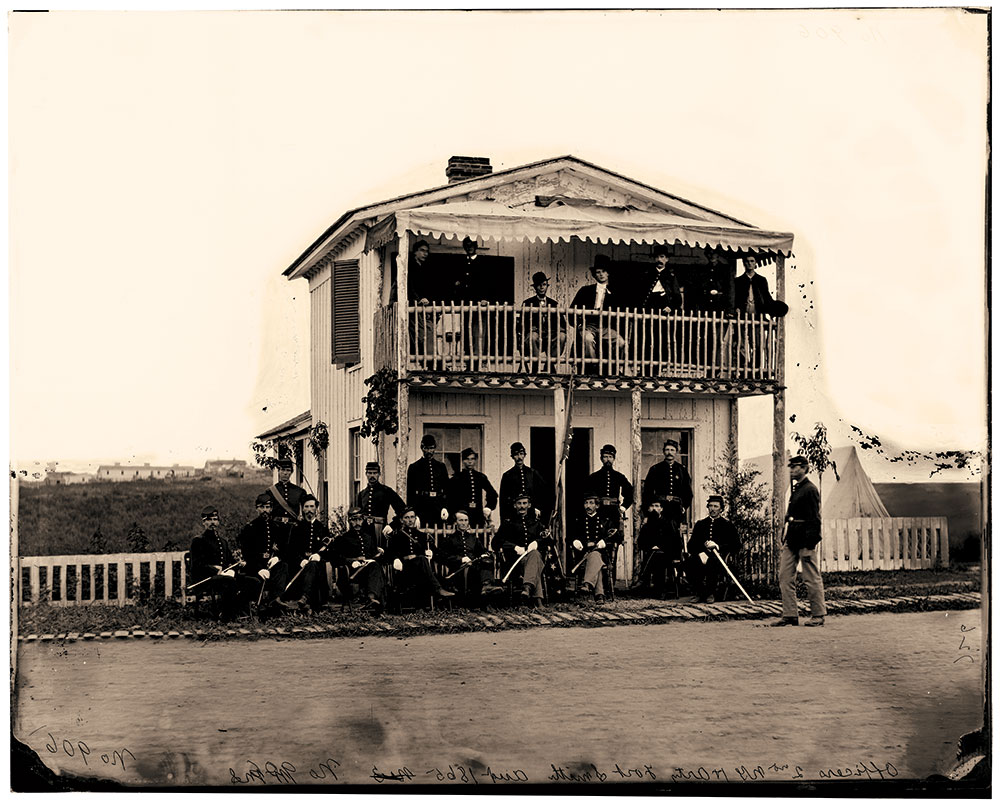 Sword-bearing officers on the porch of a building.