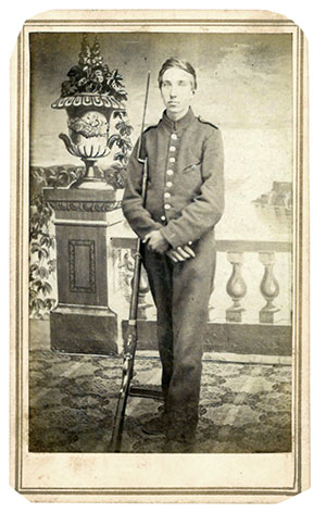 OBSOLETE, NON-ISSUE GUN. Prop: YES. Details: The antiquated Hall rifle held by this private attired in a New York State militia jacket is clearly a photographer's prop. Carte de visite  by A.P. Hart of Elmira, N.Y. Michael J. McAfee collection.