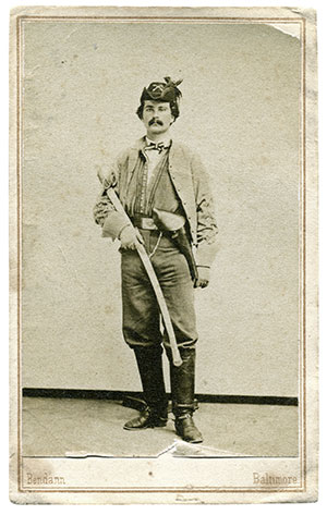 HOLSTERED REVOLVER.Prop: NO. Details: A captain in the 43rd Battalion Virginia Cavalry, or Col. John Singleton Mosby's Rangers, Julian Prosser Lee appears dressed and equipped for active campaigning.Carte de visite by Daniel and David Bendann of Baltimore, Md. The late William A. Turner collection.