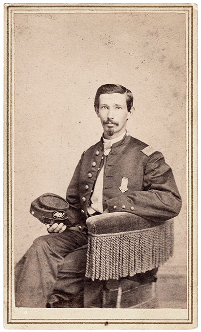 2nd Lt. Blakeslee pictured wearing a badge with the insignia of the 18th Corps, to which his regiment belonged from 1863 to 1865. Carte de visite by R.S. De Lameter of Hartford, Conn., about 1865. Author's collection.