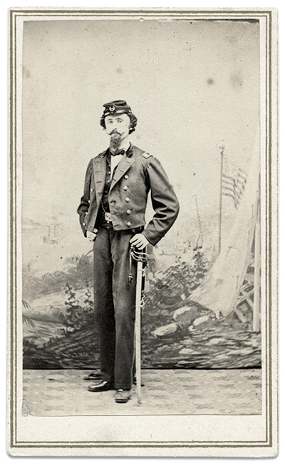 Appearing gaunt from his wounds and captivity, Samuel Miller Quincy posed for this portrait in New Orleans as a staff officer with U.S. Colored Troops. He wears an officer's jacket a la Custer and carries a Model 1850 officer's sword. Carte de visite by A. I. Blauvelt of Port Hudson, La. Author's collection.