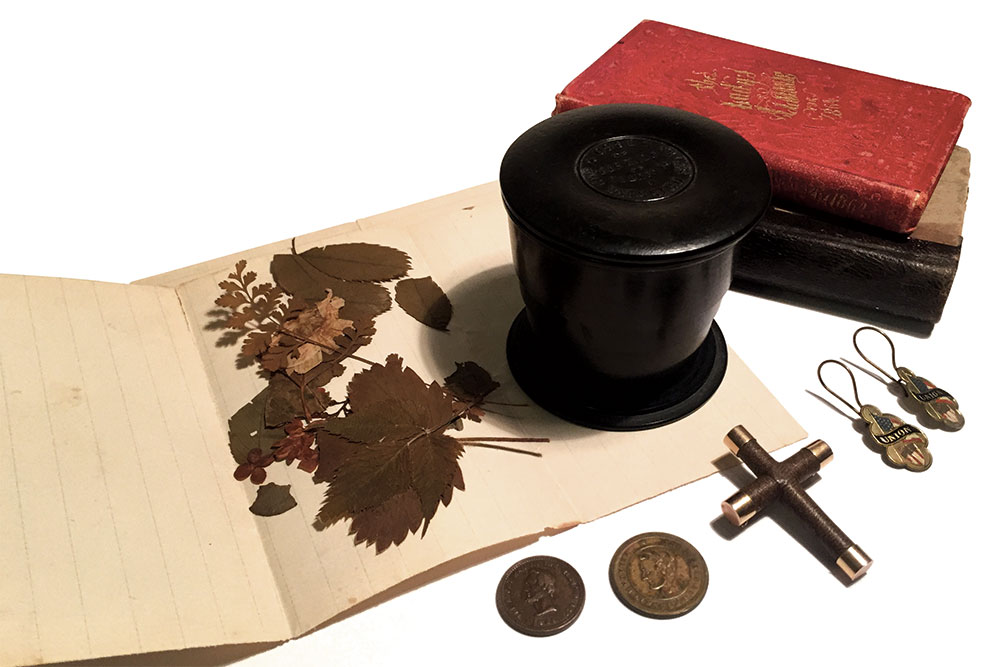Rebecca's Relics: Items from Pomroy's wartime years include flora from the White House conservatory gardens, a collapsible thermoplastic drinking cup, books, patriotic Union earrings, a cross made from her hair and two 1864 campaign tokens featuring the likeness of President Lincoln.