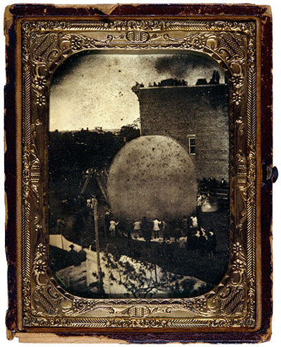 """On June 18, 1857, """"Professor"""" Steiner inflated his balloon in Erie, Pa., with the help of the townspeople. This image, known as """"The Steiner Ambrotype,"""" is recognized as the earliest photograph of a balloon in America.National Air and Space Museum collections. Smithsonian Museum, Washington, D.C."""