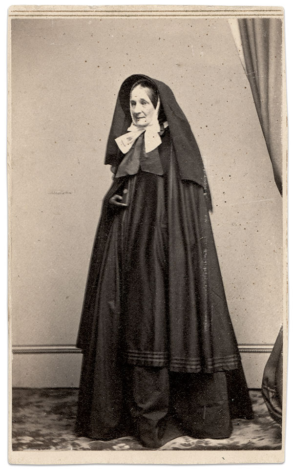 AIDING THE WOUNDED LEFT BEHIND: Sister Adelaide Blanchard Tyler, an Episcopal Deaconess born in Massachusetts, evacuated wounded and neglected soldiers housed in the local police station. Carte de visite by Mathew B. Brady of New York City. Ronald S. Coddington Collection.