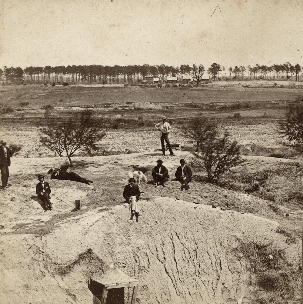 """Early view of """"The Crater, or Mine, near Petersburg."""" Stereoview by Selden & Co. of Richmond, Va. Author's collection."""