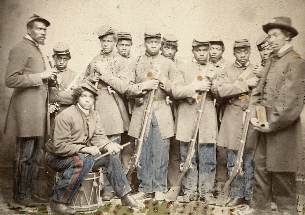 Group at L'Overture Hospital, Alexandria, Va., about December 1864-April 1865, from left to right: Tobias Trout, 31st USCT, Wounded, Crater; William DeGraff, 22nd USCT, Sick; John H. Johnson, 27th USCT, Sick, diarrhea and rheumatism; Jerry Lisle, 28th USCT, Wounded, Crater; Leander Brown, 30th USCT, Wounded, Crater; Samuel Bond, 19th USCT, Sick; Robert Deyo, 26th USCT, Sick, pleurisy; Adolphus Harp, 19th USCT, Wounded, Crater; Stephen Vance, 30th USCT, Wounded, Crater; George H. Smith, 31st USCT, Wounded, Crater; Adam Bentley, 19th USCT, Wounded, Crater; Chauncey Leonard, Chaplain, USCT, Assigned to hospital. Author's collection.