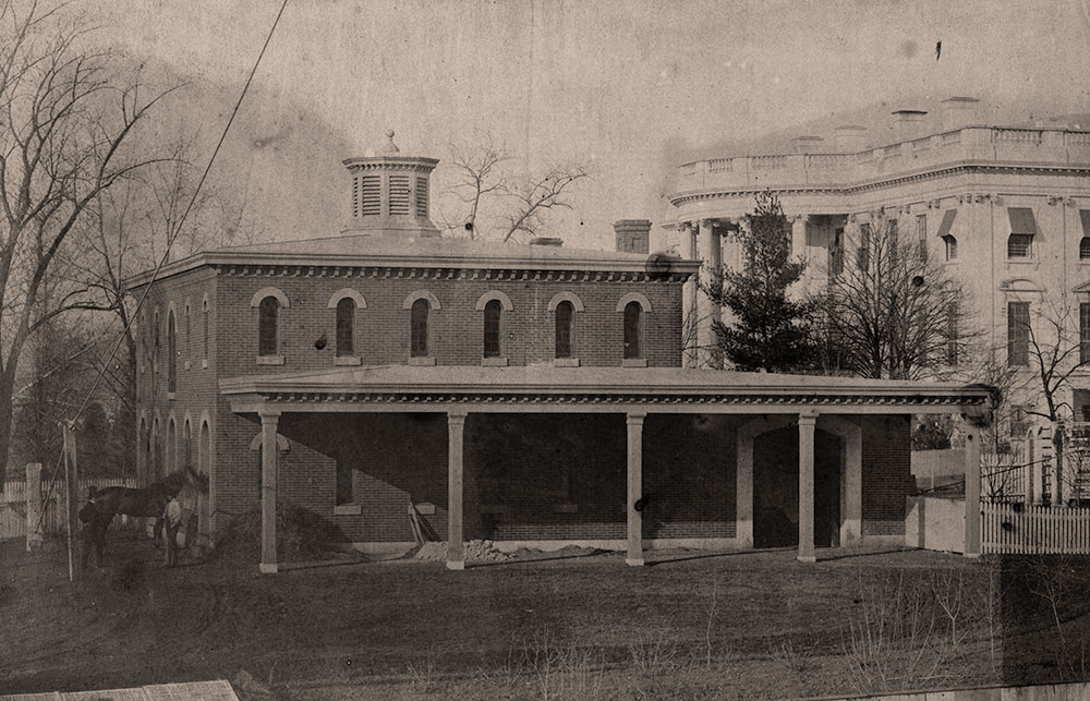 The President's stables as they appeared a few years before the war. The White House is visible in the background. Salted paper print by Lewis E. Walker of Washington, D.C. Library of Congress.