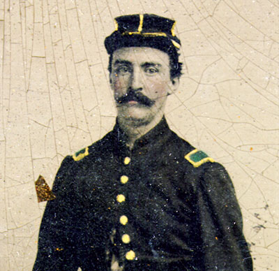 Walker is pictured in this detail of a half-plate tintype in an early war uniform, possibly supplied by Old Noah to the Richmond Zouaves.