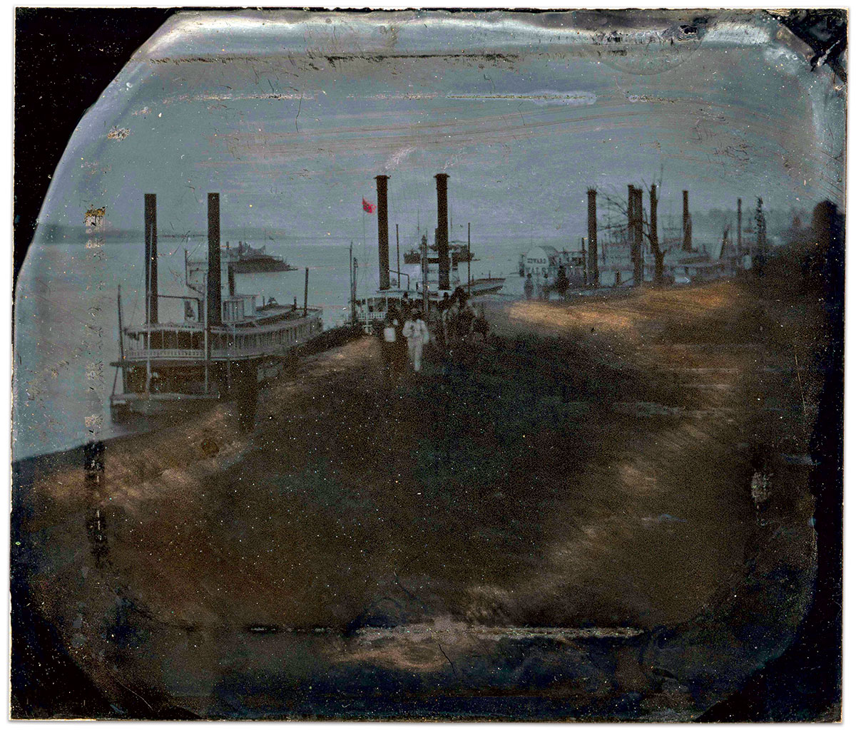The Edward Walsh appears moored at the far end of this row of steamers. An unidentified side-wheel gunboat and an Eads gunboat, so named for wealthy St. Louis industrialist James Buchanan Eads, lie just off shore. Several laden wagons approach the camera. Sixth-plate tintype (reversed) possibly by Andrew D. Lytle of Baton Rouge, La.