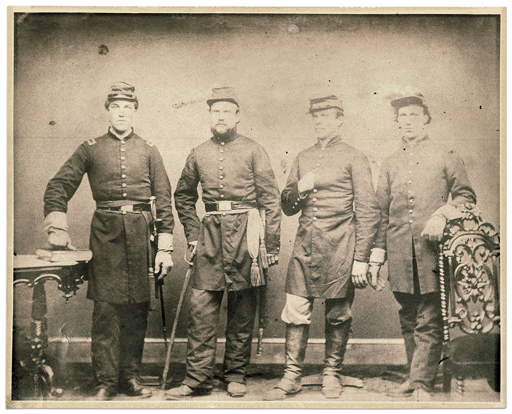 """From left to right: Lt. Robert Warner, Lt. and Quartermaster Horace Warner and Pvt. Hiram Warner of Berdan's 2nd U.S. Sharpshooters, and Pvt. William Warner of the 42nd Pennsylvania Infantry """"Bucktails,"""" taken in Washington, D.C., in June-July 1862. All the brothers survived except for Hiram, who was killed at the Battle of Antietam. Albumen print by an anonymous photographer. Ronn Palm's Museum of Civil War Images, Gettysburg, Pa."""