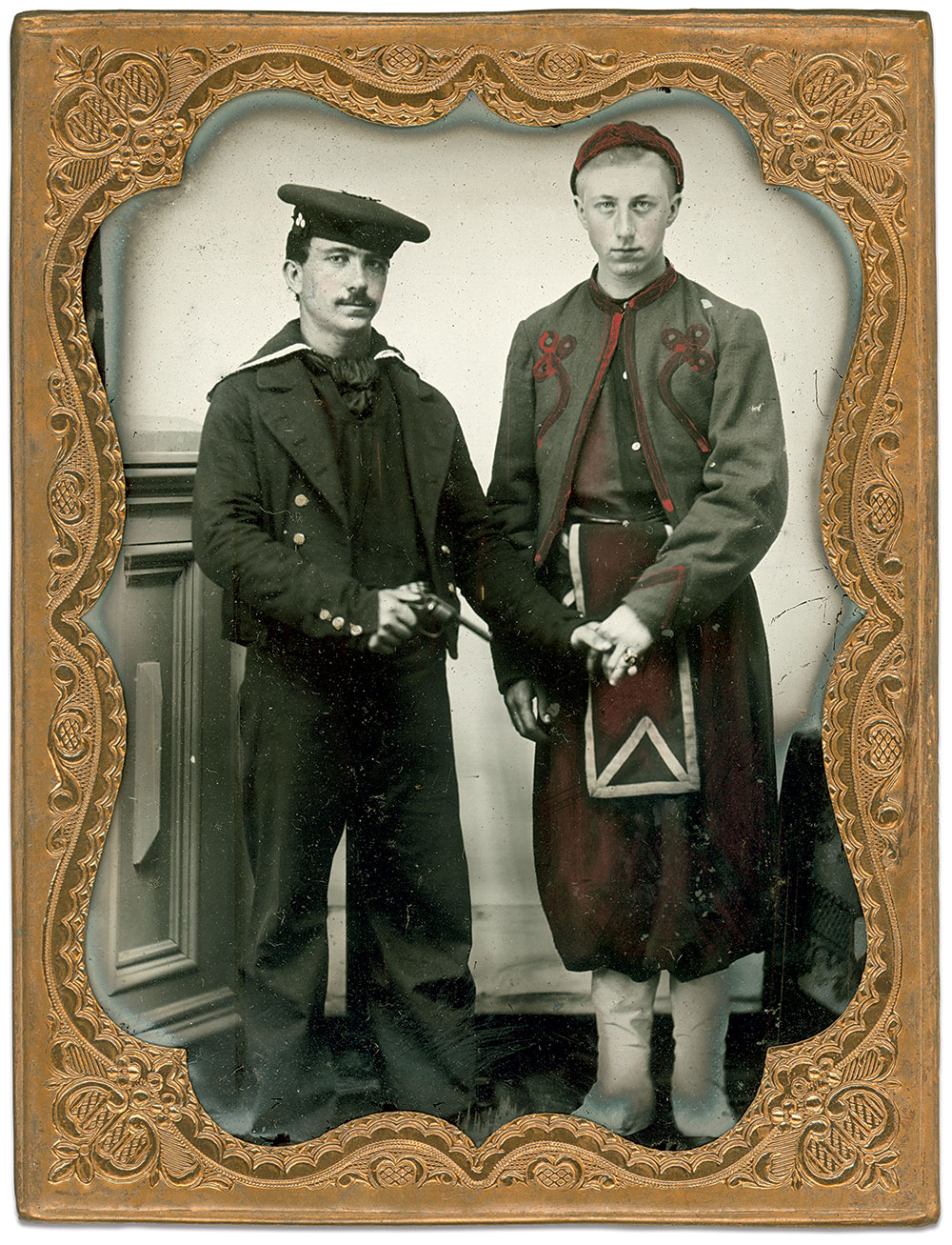 The subtext in this portrait of a revolver-toting sailor and his Duryée Zouave friend is the prominent ring worn by the soldier. Tinted in gold, it may link the pair to a college or social fraternity.Quarter-plate ambrotype by an anonymous photographer. Bob Lucas Collection.