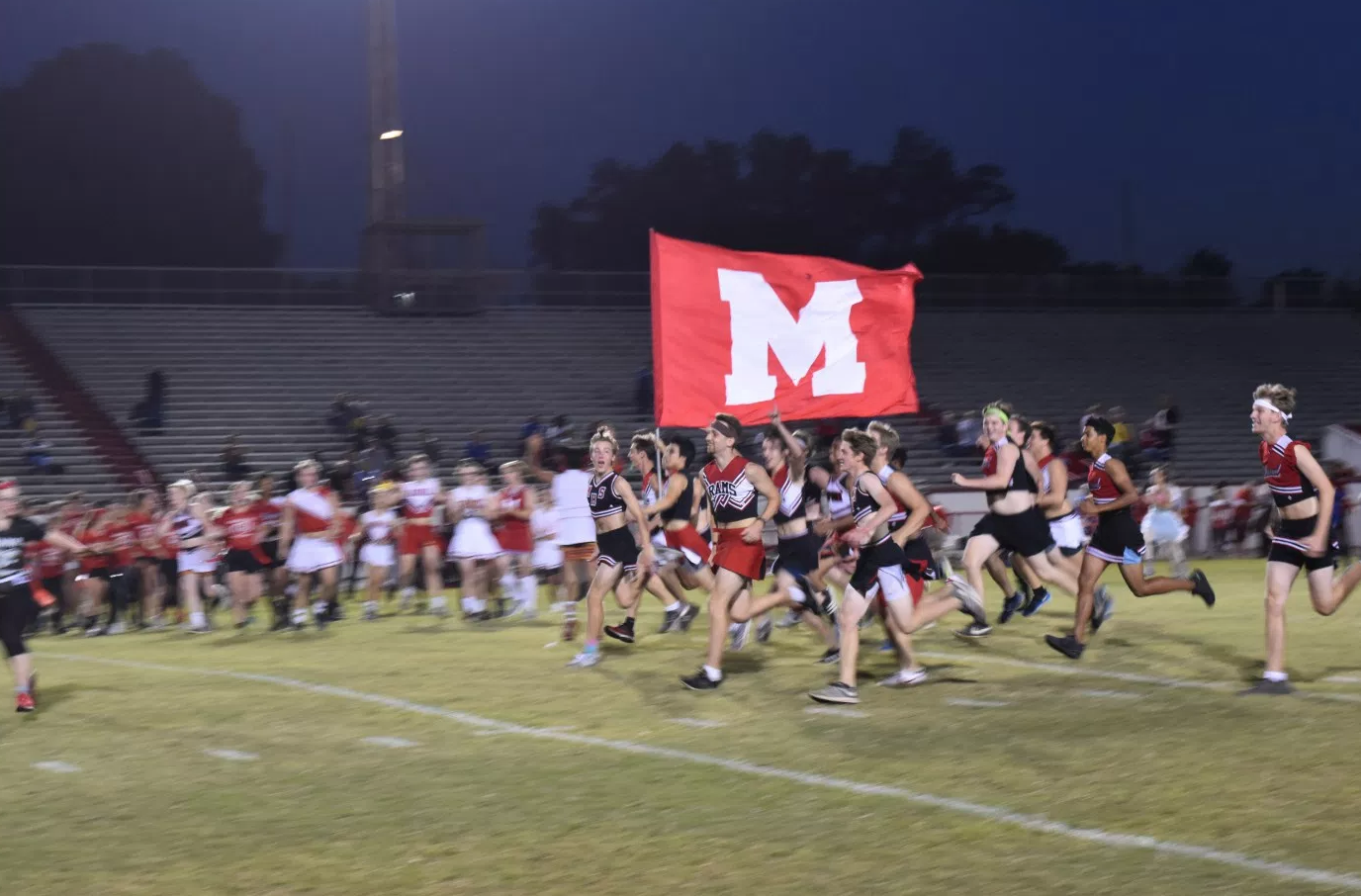 Seniors run the flag down the field after their victory. Photo by Piper Hansen.