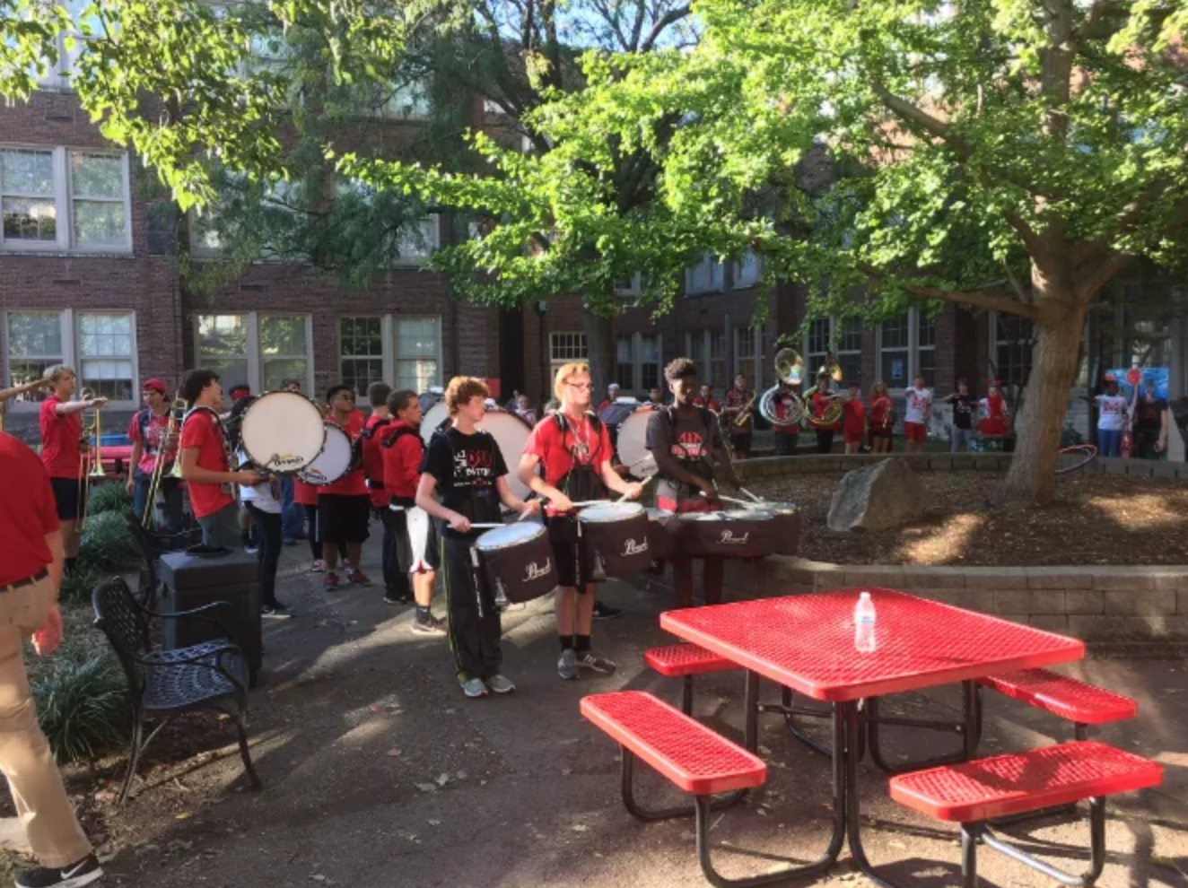 The marching band performs part of their competition show for a small group of alumni in the courtyard at the festival. Photo by Reece Gunther.