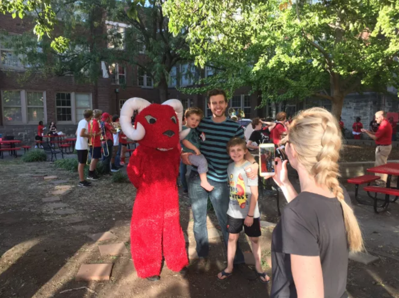 Family takes a photo with Rammy, the mascot, at the festival. Photo by Reece Gunther.
